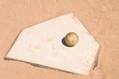Baseball on home plate Stock Image