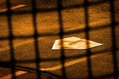 Baseball Home Plate and Backstop Fence stock photography