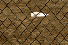 Baseball Home Plate and Backstop Fence. Baseball home plae and backstop chainlink fence wire Stock Images