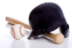 Baseball Items. On a white background including a batting helmet a wooden baseball bat and a baseball Stock Photo