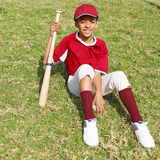Baseball kid. Baseball sports kid in kit with baseball and bat Stock Image