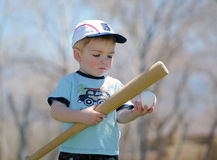 Baseball Kid. A small boy with a baseball bat and ball Stock Photos
