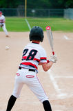 Baseball kid batting Royalty Free Stock Images