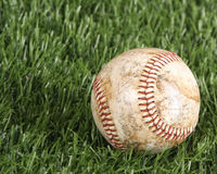 Baseball laying in the grass Royalty Free Stock Images