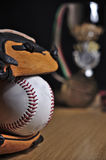 Baseball leather glove with ball and trophy royalty free stock image