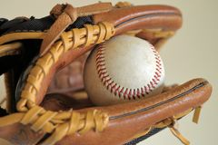 Baseball in leather glove - little league, sports royalty free stock image