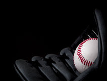 Baseball in glove. Baseball in left handed glove Stock Photography