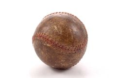 Baseball Memories. A very old basball that has turned dark brown from age.  Photographed on a white background Royalty Free Stock Photos
