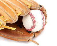 Baseball in mitt. A baseball sits in a mitt, set against a white background Stock Photos