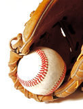 Baseball in Mitt. A weathered baseball sits in a mitt, set against a white background with room to expand left or down for copy Royalty Free Stock Photos