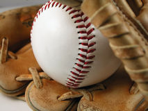 Baseball and Mitt. Macro shot of a baseball and mitt with a white background Royalty Free Stock Image