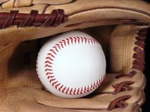 Baseball and mitt close up. A close up view of a baseball in a mitt Royalty Free Stock Image