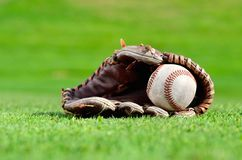 Baseball in mitt on green grass Royalty Free Stock Photo
