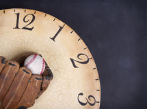 A baseball and mitt on an old vintage clock Royalty Free Stock Images
