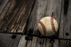 Baseball. And mitt on rustic wooden background stock image