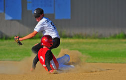 Baseball moving for the tag. royalty free stock images