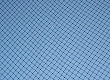Baseball netting. Behind home base to stop foul balls stock photos