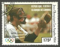 Baseball at the Olympics. Comoros - stamp printed 1980, Multicolor Air mail Edition, Topic Olympic Games and Baseball, Series 1984 Summer Olympics, Baseball Stock Image