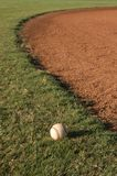 Baseball in the outfield Stock Photography