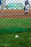 Baseball outside of a baseball field with batter and catcher at background Stock Images