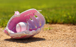 Baseball in Pink Female Glove Royalty Free Stock Image