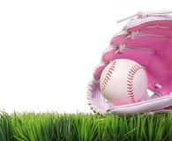 Baseball in Pink Female Glove on Green Grass, isolated Royalty Free Stock Photo