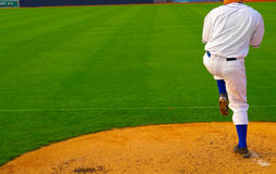 Baseball pitcher. Pro baseball  pitcher throwing the ball from the mound Royalty Free Stock Photography