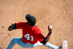 Baseball Pitcher. A baseball pitcher throwing a pitch with copy space Stock Image