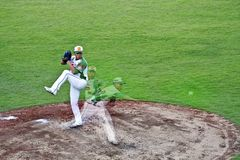 Baseball pitcher in action. Tianmu, Taiwan - September 1,2012 : Lin, a Sinon Bulls pitcher of CPBL, pitch for the Chinese Professional Baseball League game on Stock Images