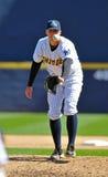 Baseball pitcher catching ball - return throw Royalty Free Stock Photography