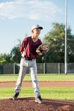 Young Boy About to Pitch. Baseball Pitcher on the field about to pitch the ball. Outside. Warm, sunny day royalty free stock photos
