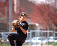 Baseball pitcher focus Stock Photography
