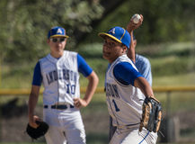 Baseball Pitcher Gets Ready For Action. A baseball pitcher  at Anderson High School, Anderson, California Royalty Free Stock Photography