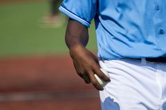 Baseball pitcher holding baseball about to throw the ball.  royalty free stock image