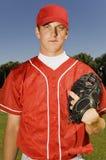Baseball pitcher holding glove Stock Photo