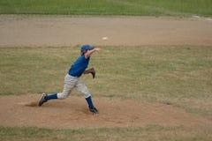 Baseball Pitcher Pitching. Teen boy baseball player pitching baseball duiring a game Royalty Free Stock Photo