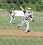 Baseball pitcher throwing the ball. Stock Photo