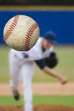 Baseball Pitcher. A baseball pitcher throwing a strike. Selective Focus on the ball coming into close view. Vertical composition Stock Photos