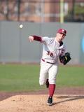 Baseball pitcher warming in the bullpen - Stock Image