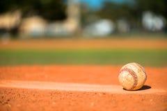 Baseball on Pitchers Mound. Well Worn Baseball on Pitchers Mound stock photos