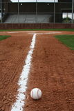 Baseball in play. Baseball in the infield with home plate in the distance Stock Photos