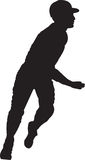 Baseball Player 01. A silhouette of a baseball player running stock photography