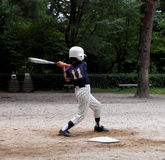 Baseball player. A boy playing baseball in a park Royalty Free Stock Images