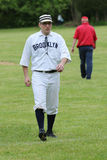 Baseball player in 19th century vintage uniform during old style base ball play Royalty Free Stock Photography