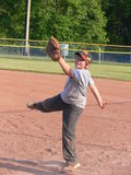 Baseball player. A young baseball player in training on late afternoon with his team Stock Image
