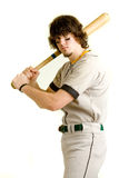 Baseball Player. A young male baseball player batting stock photo