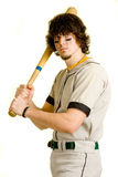 Baseball Player. A young male baseball player batting royalty free stock photo