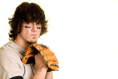 Baseball Player. A young male baseball player standing royalty free stock images