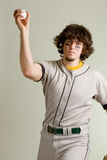 Baseball Player. A young male baseball player pitching royalty free stock photography