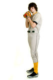 Baseball Player. A young male baseball player pitching stock photography